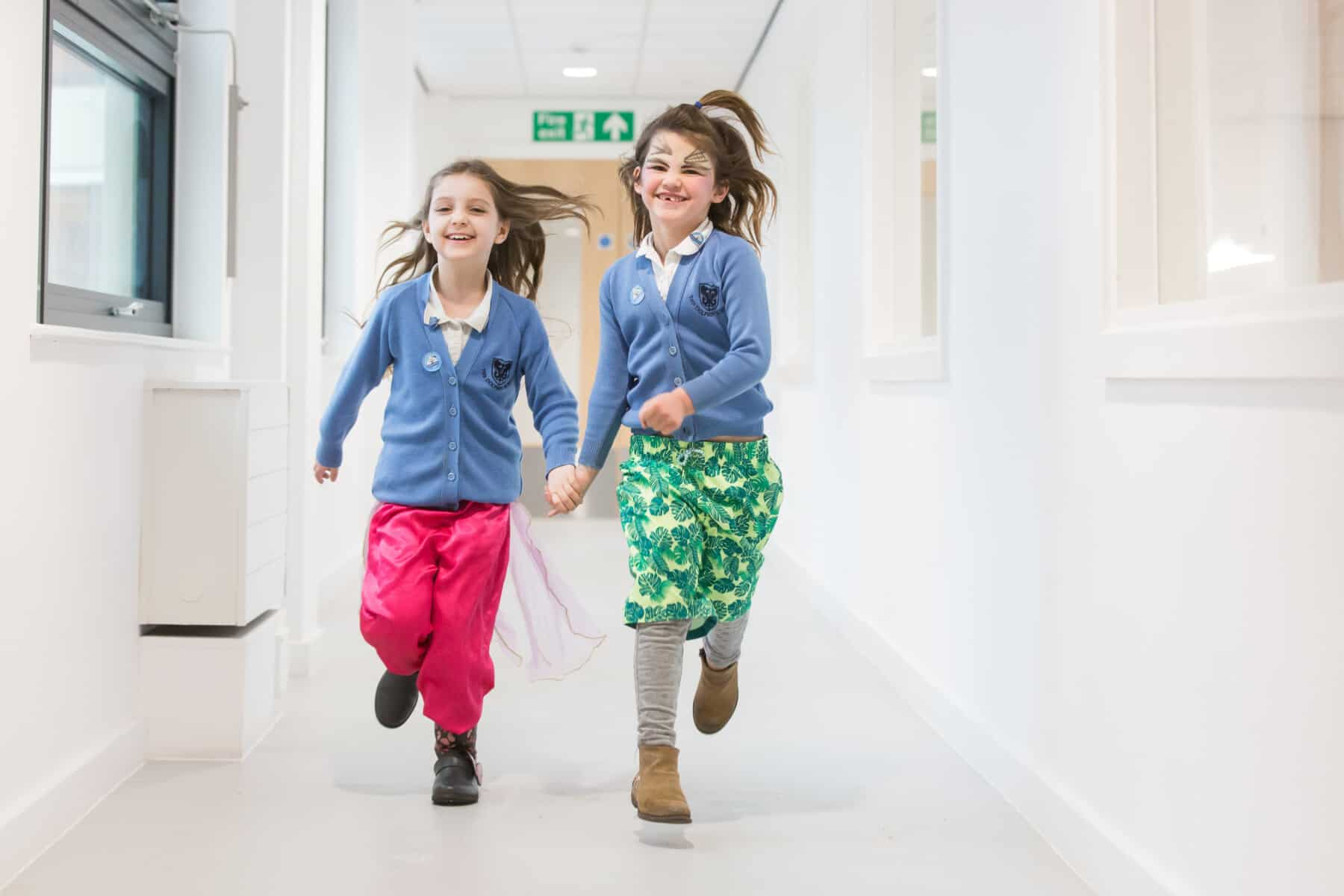 girls from school running down the corridor