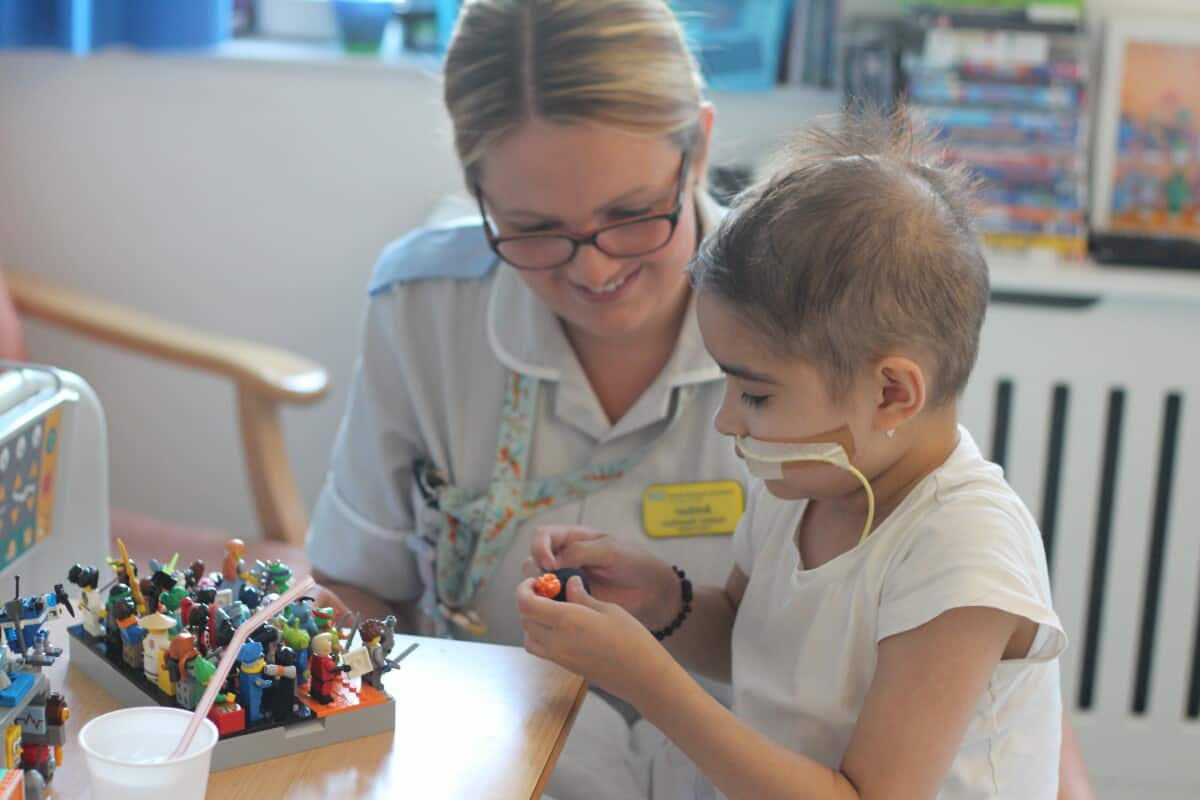 child in hospital playing