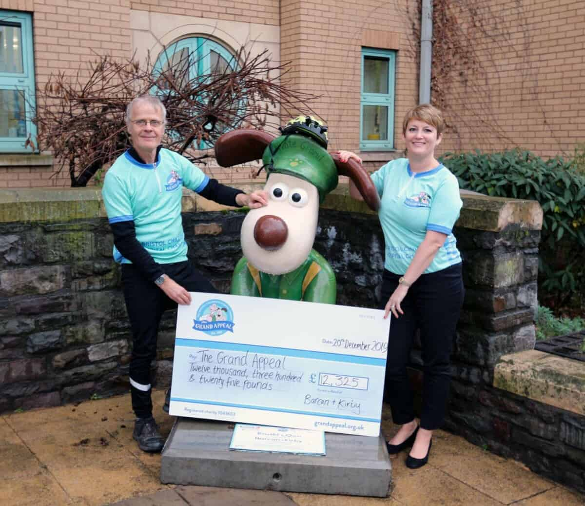 barcan and kirby employees near private gromit sculpture